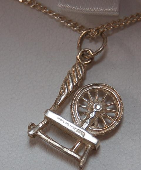Sterling Silver 3/4 inch Spinning Wheel Pendant with Matching Chain